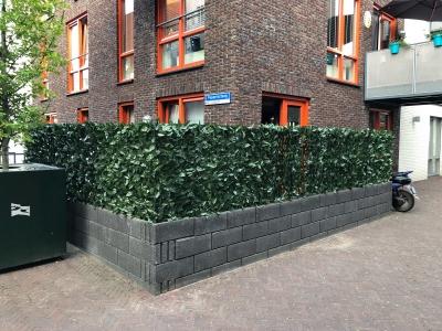 Renoveer-de-tuin-met-een-kunsthaag
